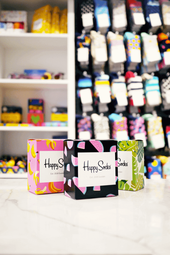 happy socks boxes in a retail store