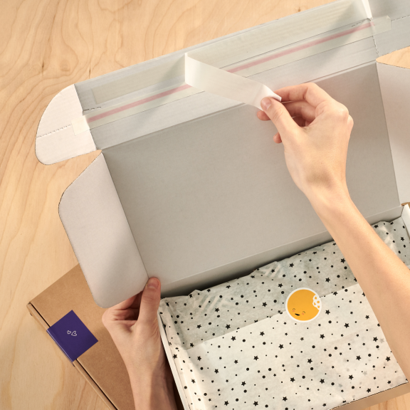 white plain delivery box with peel adhesive strips