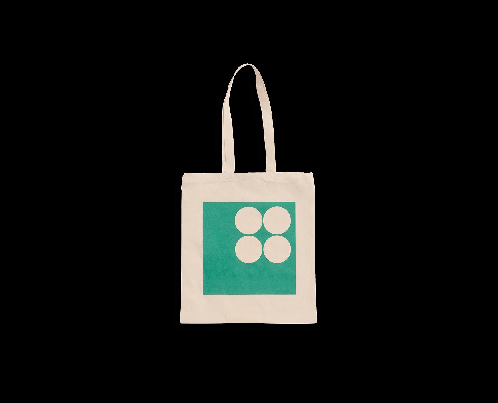 Ljusbeige väska i ekologisk bomull med grönt tryck