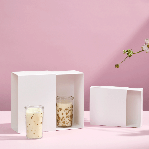 white cardboard drawer boxes with candles